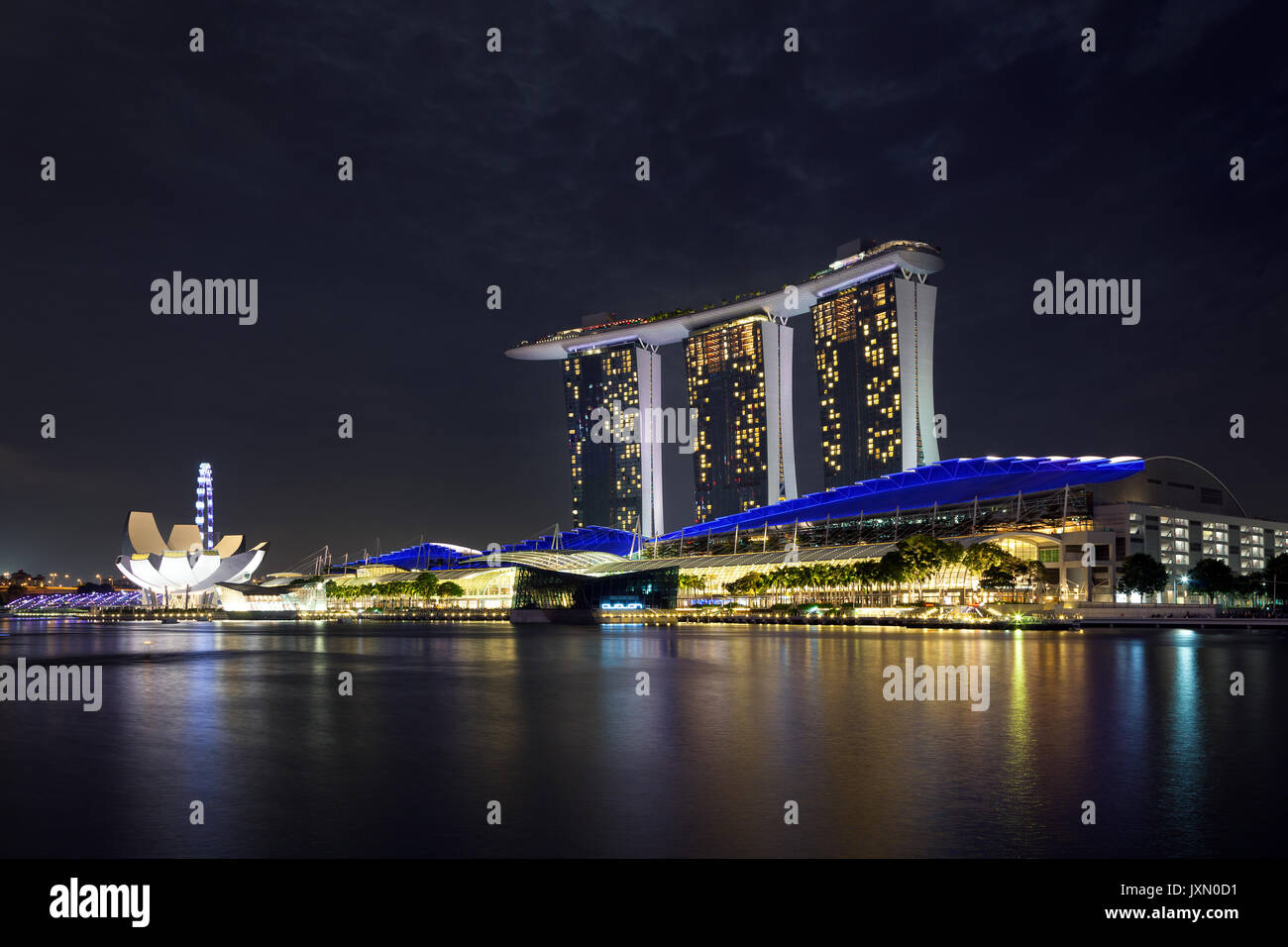 Singapore - February 21, 2016 : Marina Bay Sands by night, an integrated resort - opened in 2010 - fronting Marina Bay in Singapore - Stock Image