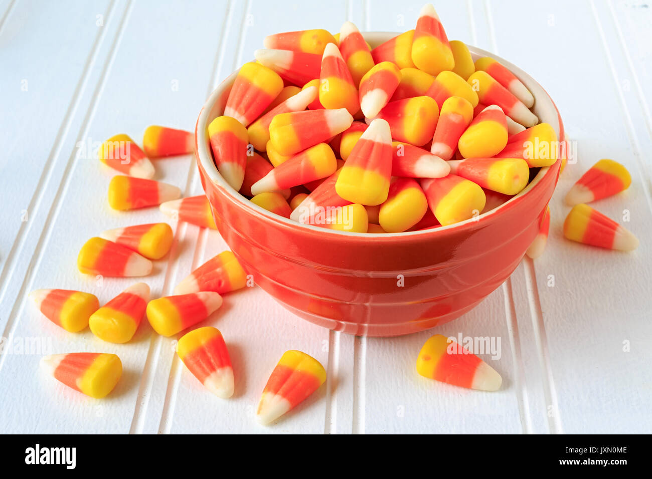 Candy corn in a ceramic bowl. - Stock Image