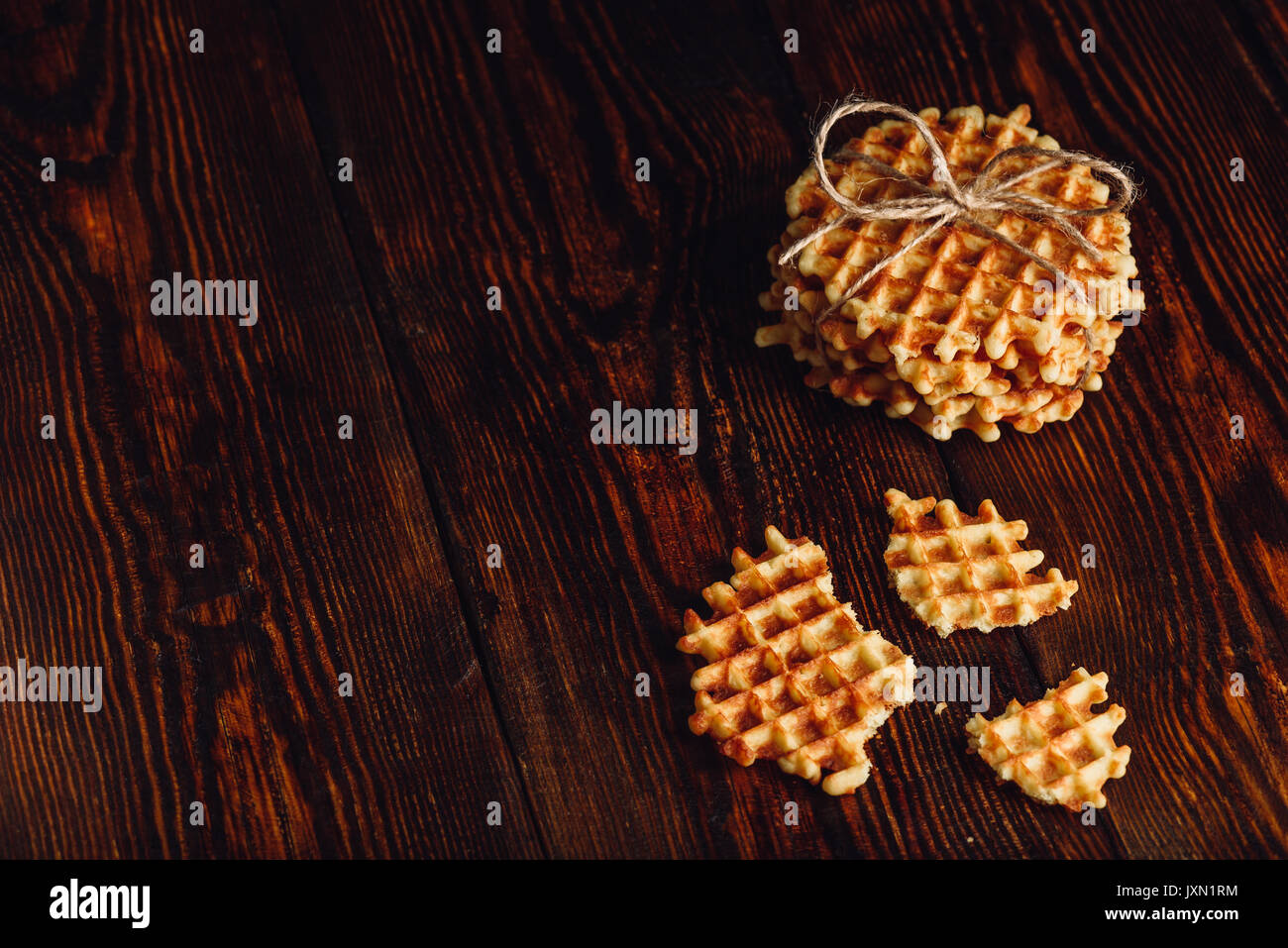 Belgian Waffles on Wooden Surface with Copy Space on the Left. - Stock Image