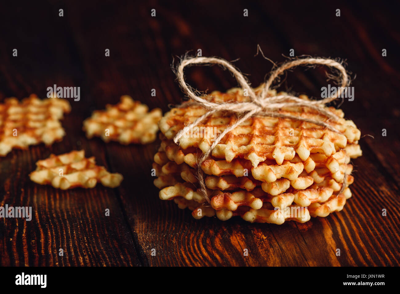 Belgian Waffles Stack with Pieces of Waffle. Stock Photo