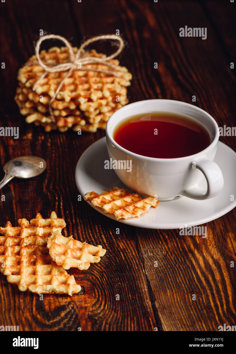 White Cup of Tea and Belgian Waffles for Dessert. Vertical Orientation. - Stock Image
