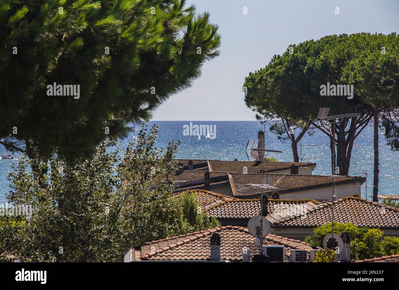 Tyrrhenian sea, view of tiled roofs, stone pines, yachts and seacoast of Terracina, Lazio, Italy - Stock Image