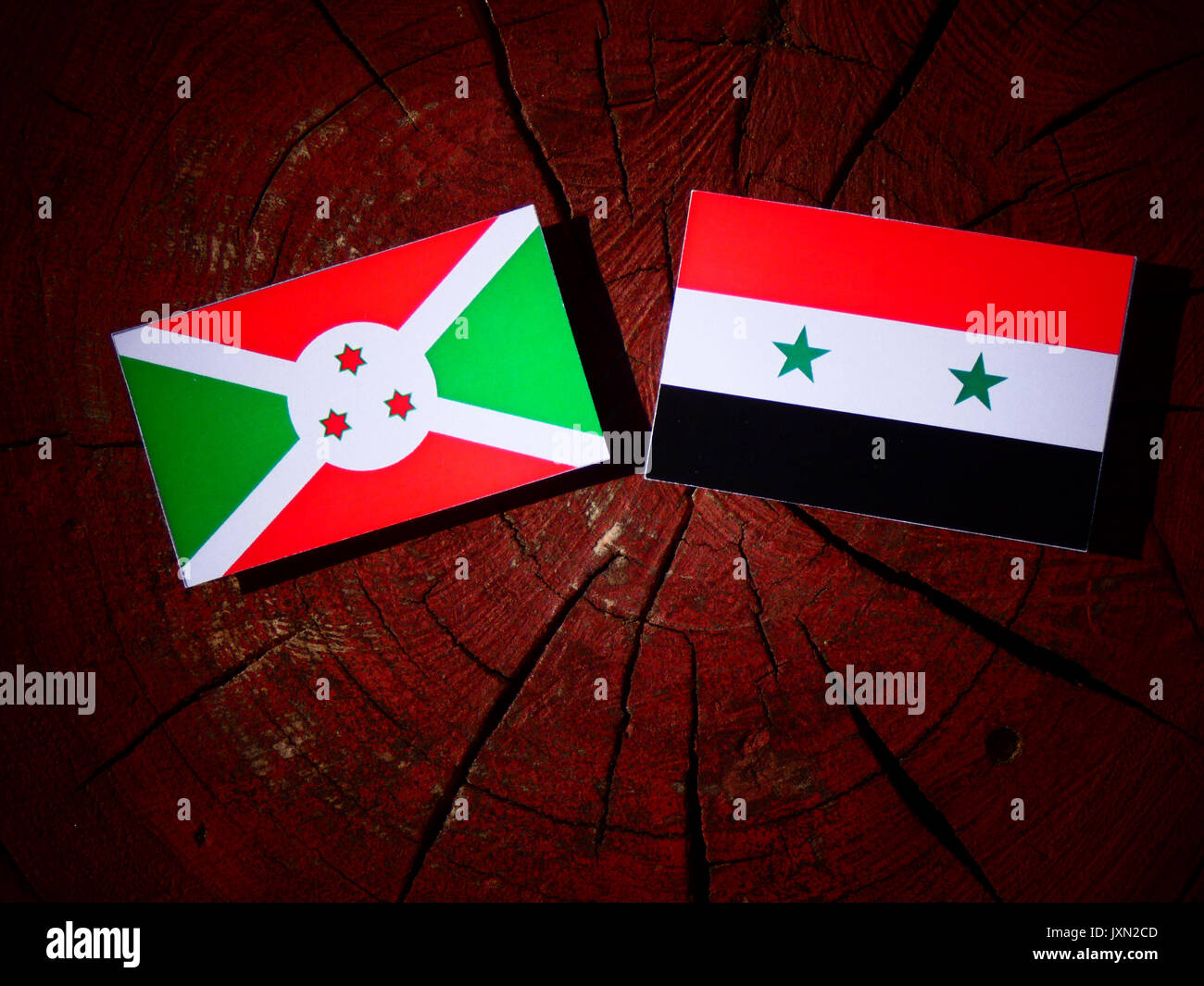 Burundi flag with Syrian flag on a tree stump isolated Stock Photo