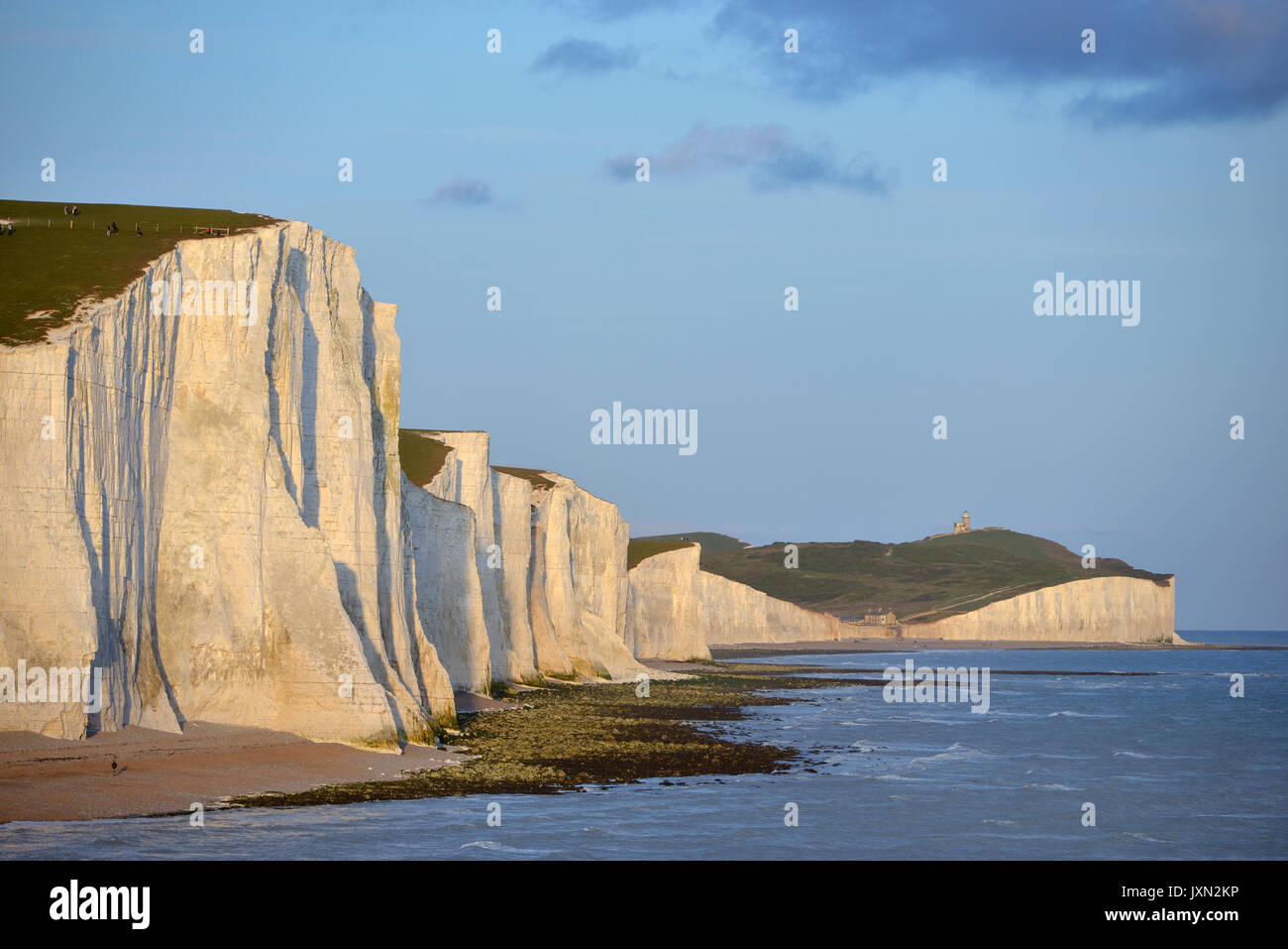 Seven Sisters chalk cliffs at sunset. - Stock Image