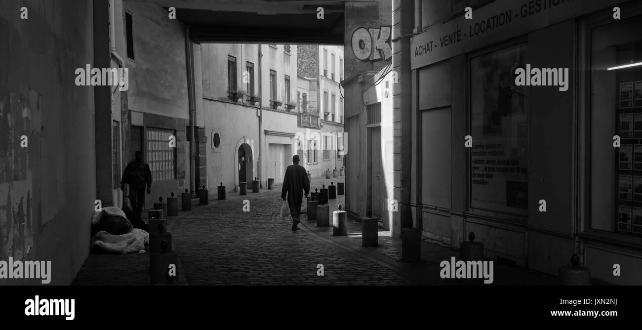 A street scene in Paris shot in black and white - Stock Image