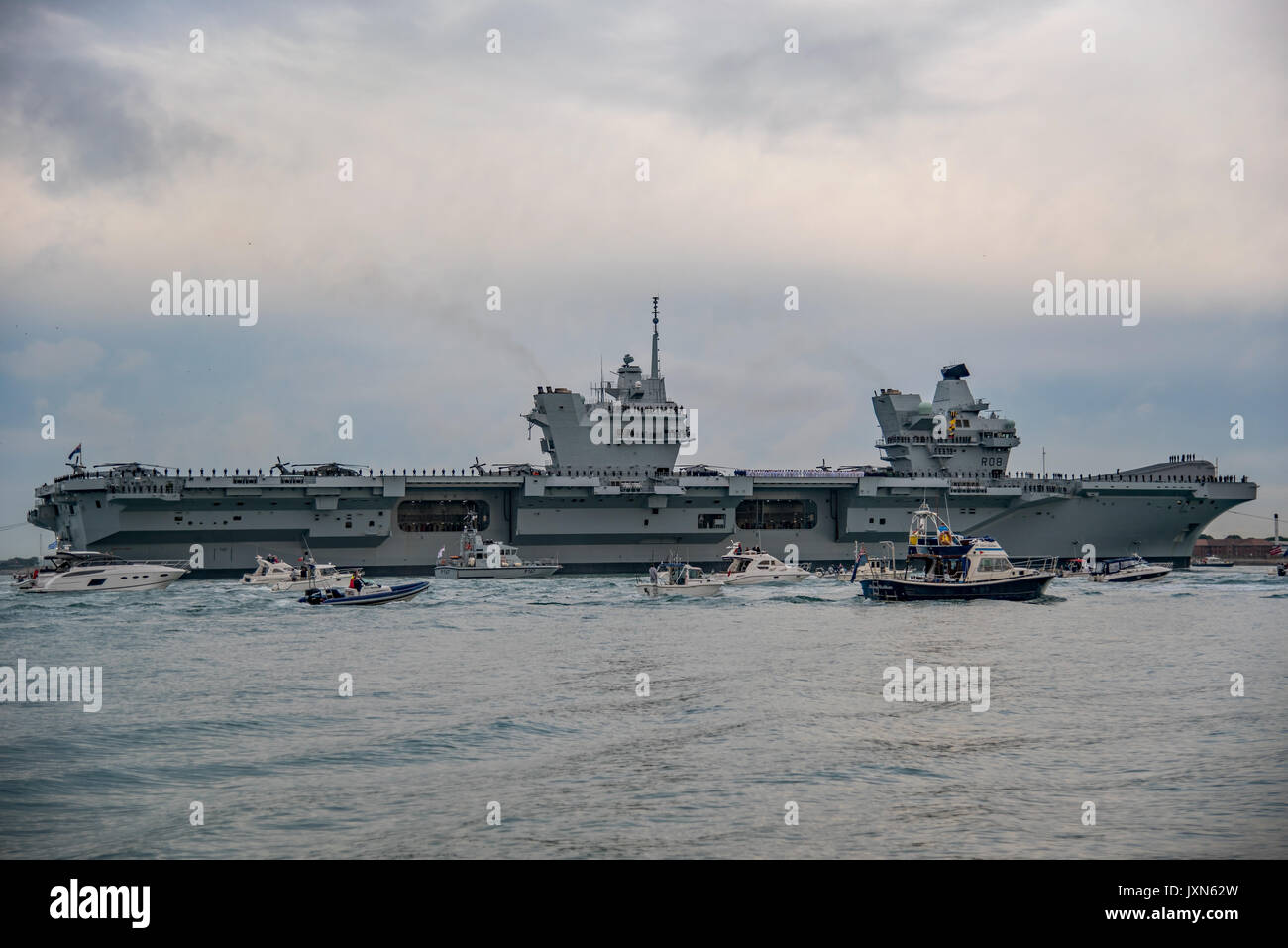 The British Royal Navy Aircraft Carrier, HMS Queen Elizabeth (R08) first arrival by the warship at Portsmouth Naval Base, UK early (am) on 16/8/17. - Stock Image