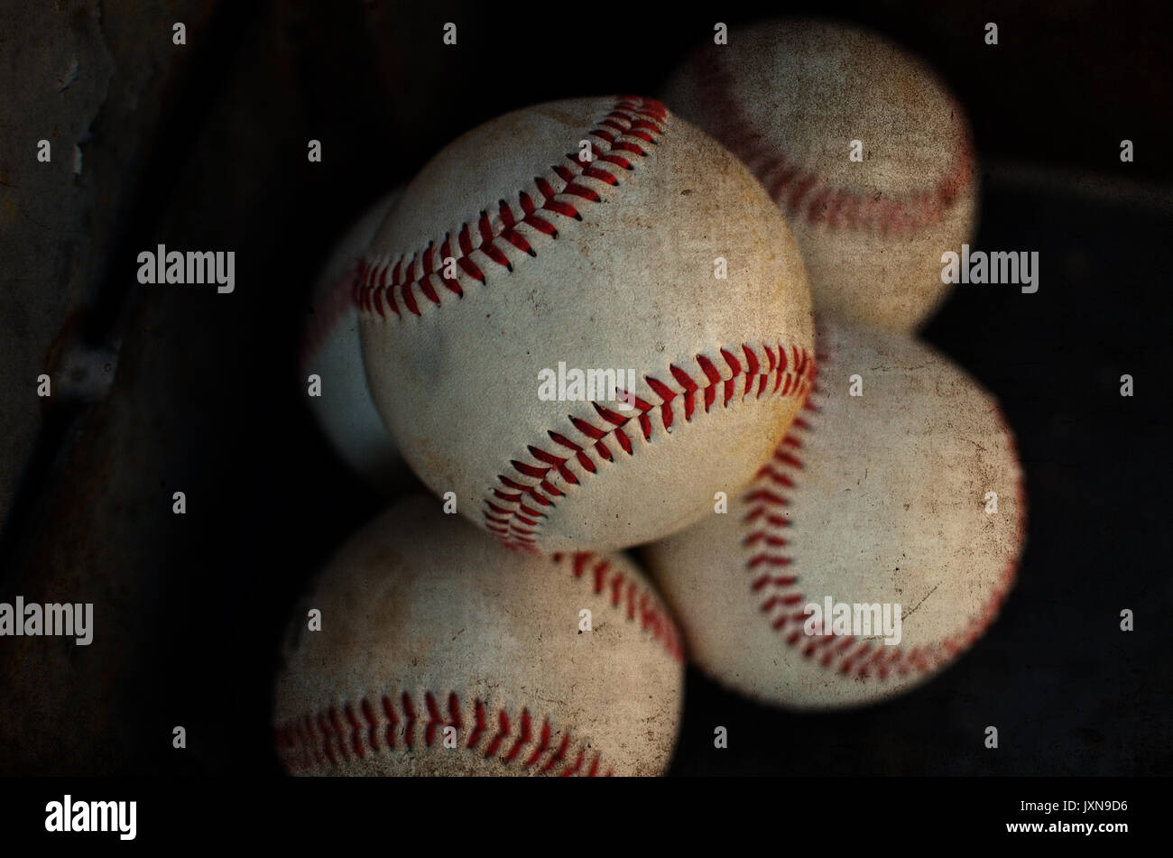 Pile of baseballs laid out for ball player, equipment needed for the game. - Stock Image