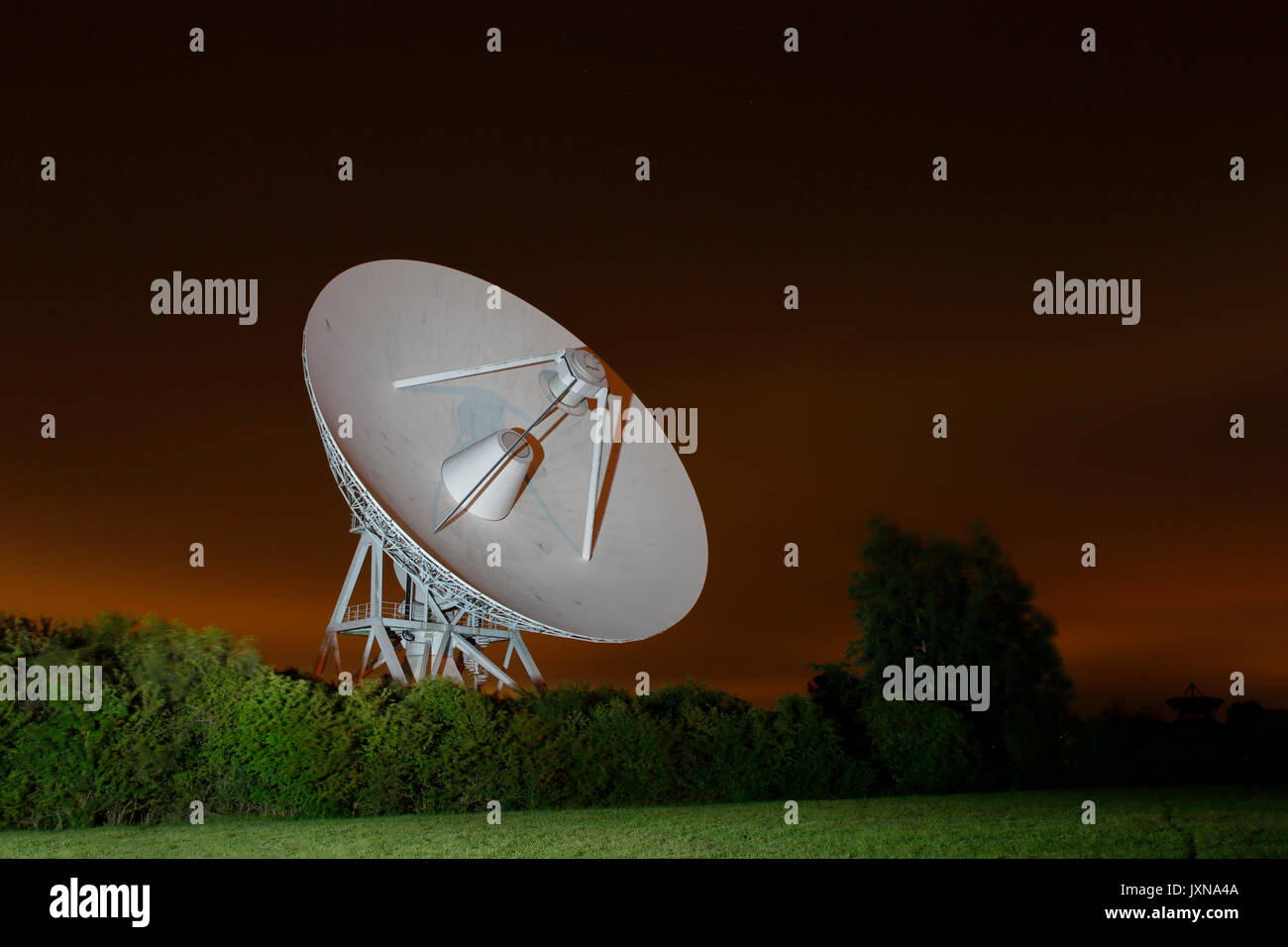 Multi Element Radio Linked Interferometer Network, MERLIN Radio telescope at the Mullard Radio Observatory at night - Stock Image