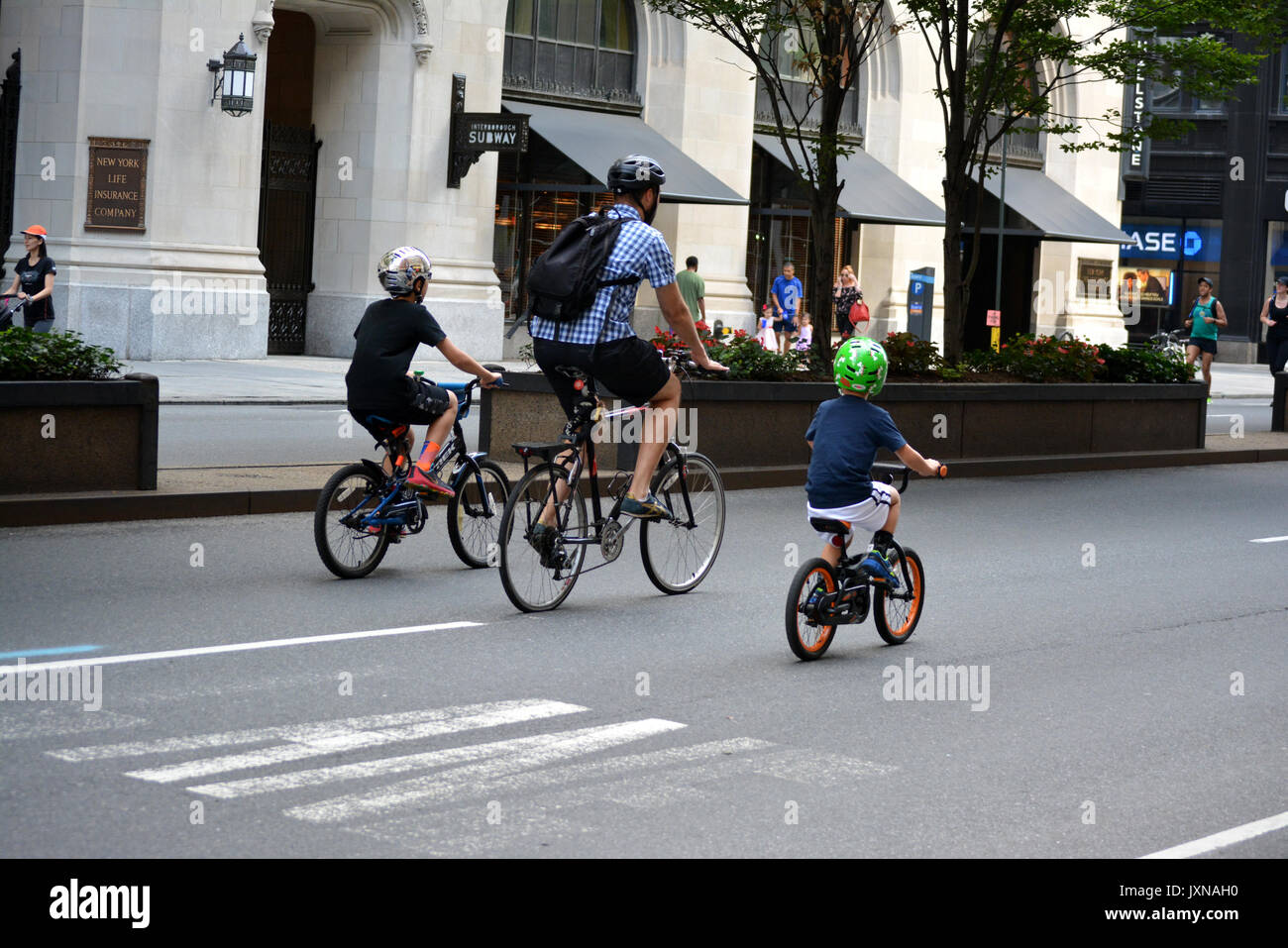 People on Park Avenue taking part in the annual car free Summer Streets event in New York City. - Stock Image