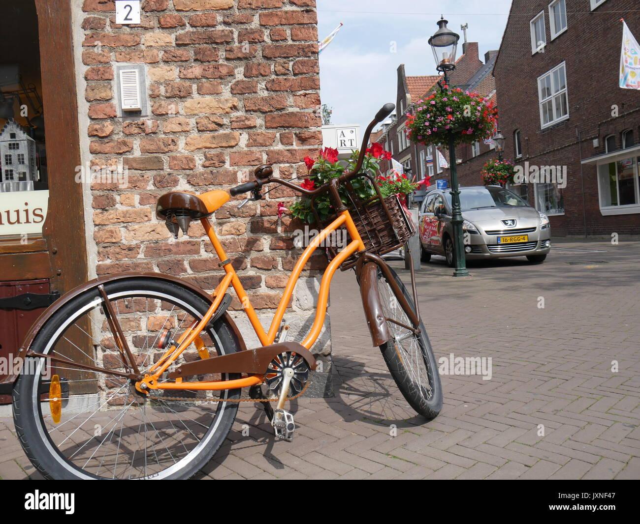 Orange bycicle in Venlo - Stock Image