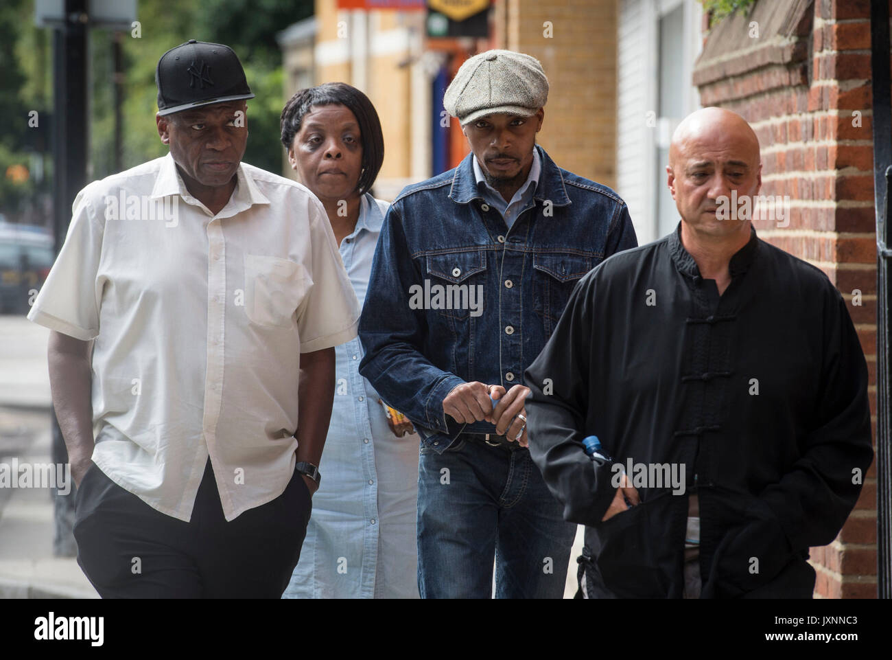 The family of Rashan Charles, including his father Esa (second right) arrive at Poplar CoronerÕs Court, in east London, where an inquest has opened into the death of the 20-year-old. - Stock Image