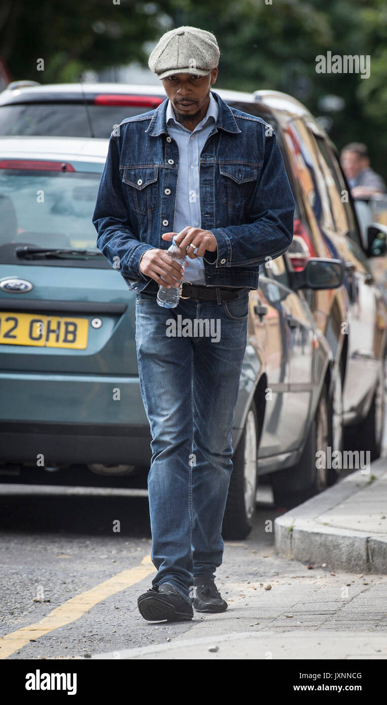 Esa Charles, the father of Rashan Charles, arrives at Poplar CoronerÕs Court, in east London, where an inquest has opened into the death of the 20-year-old. - Stock Image