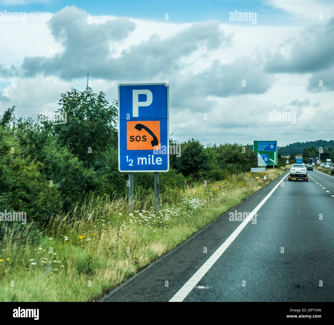 SOS sign for telephone and emergency parking on the M6 motorway in the East Midlands, heading west towards Birmingham Stock Photo