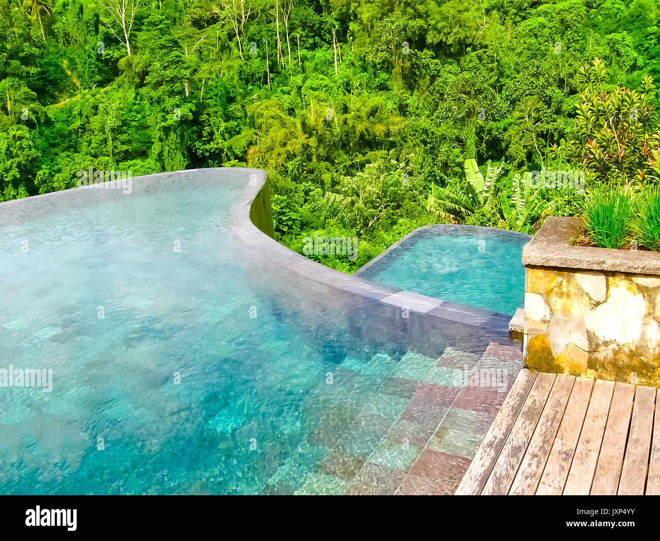 Bali, Indonesia - April 13, 2014: View of swimming pool at Ubud Hanging Gardens hotel - Stock Image