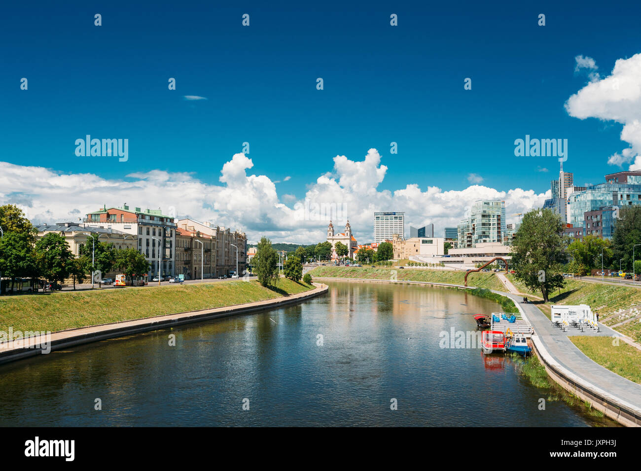 Vilnius, Lithuania  - July 5, 2016: Cityscape With Church Of St Raphael The Archangel And Former Jesuit Monastery, Radisson Blu Hotel In Sunny Summer  - Stock Image