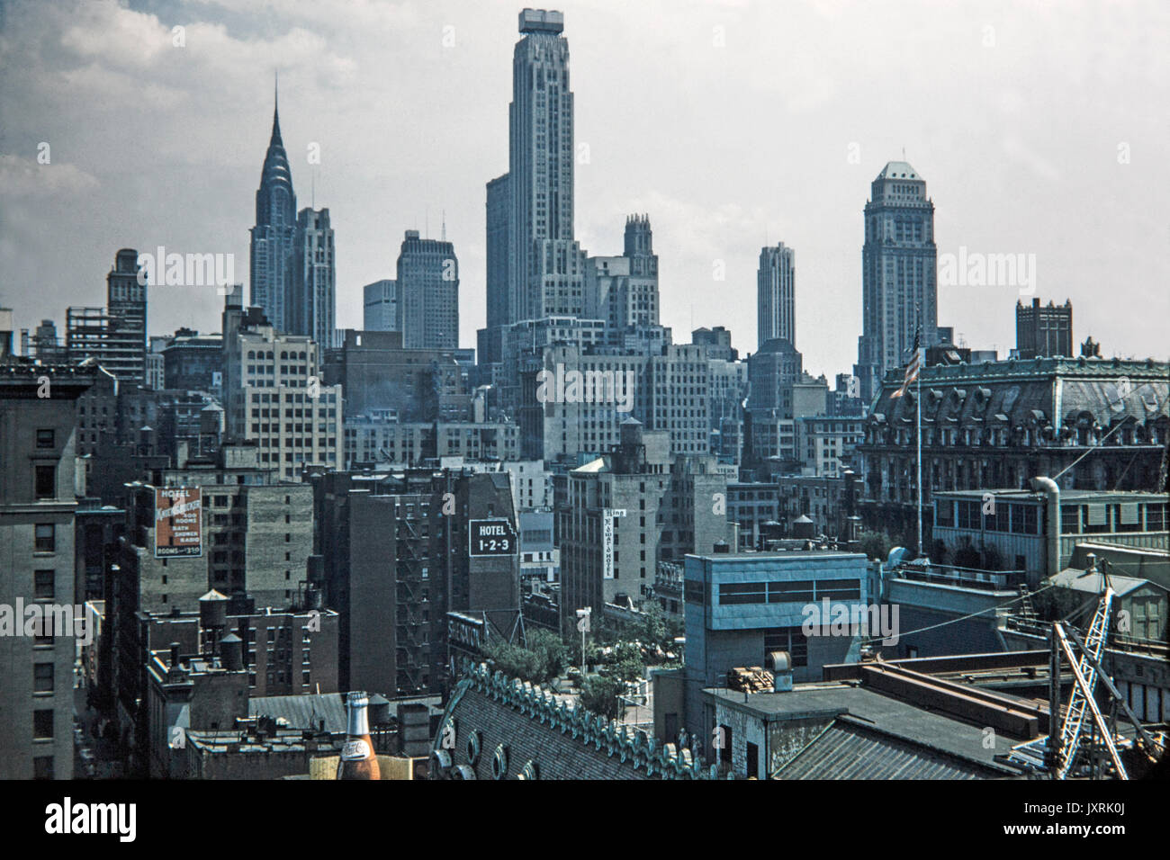 View looking across buildings in New York City in 1956. Signs can be seen for Hotel Knickerbocker, King Edward Hotel, Stock Photo