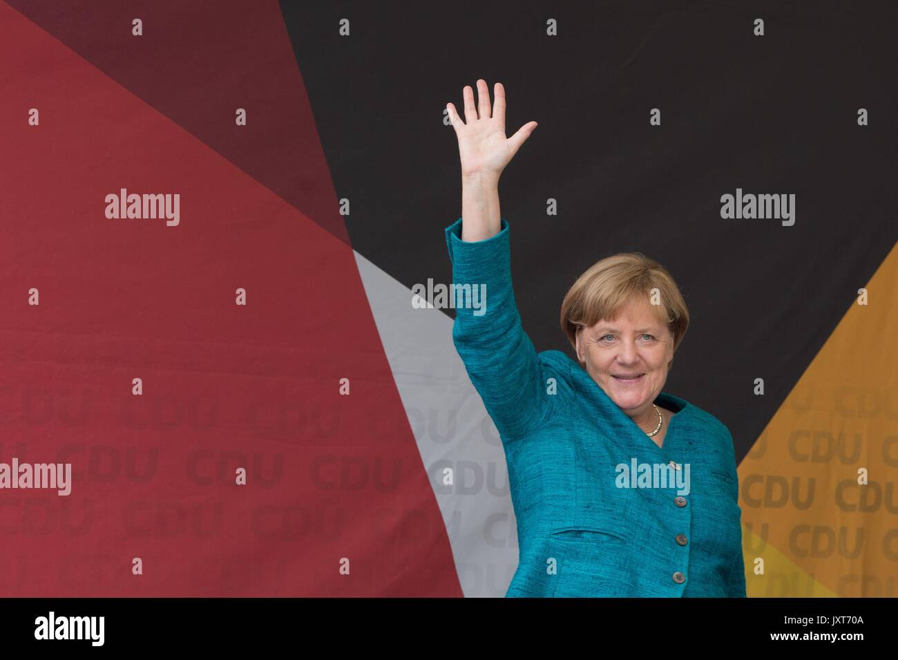 Annaberg-Buchholz, Germany. 17th Aug, 2017. German Chancellor Angela Merkel (CDU) waves from the stage during an election campaign event in Annaberg-Buchholz, Germany, 17 August 2017. Photo: Sebastian Kahnert/dpa-Zentralbild/dpa/Alamy Live News - Stock Image