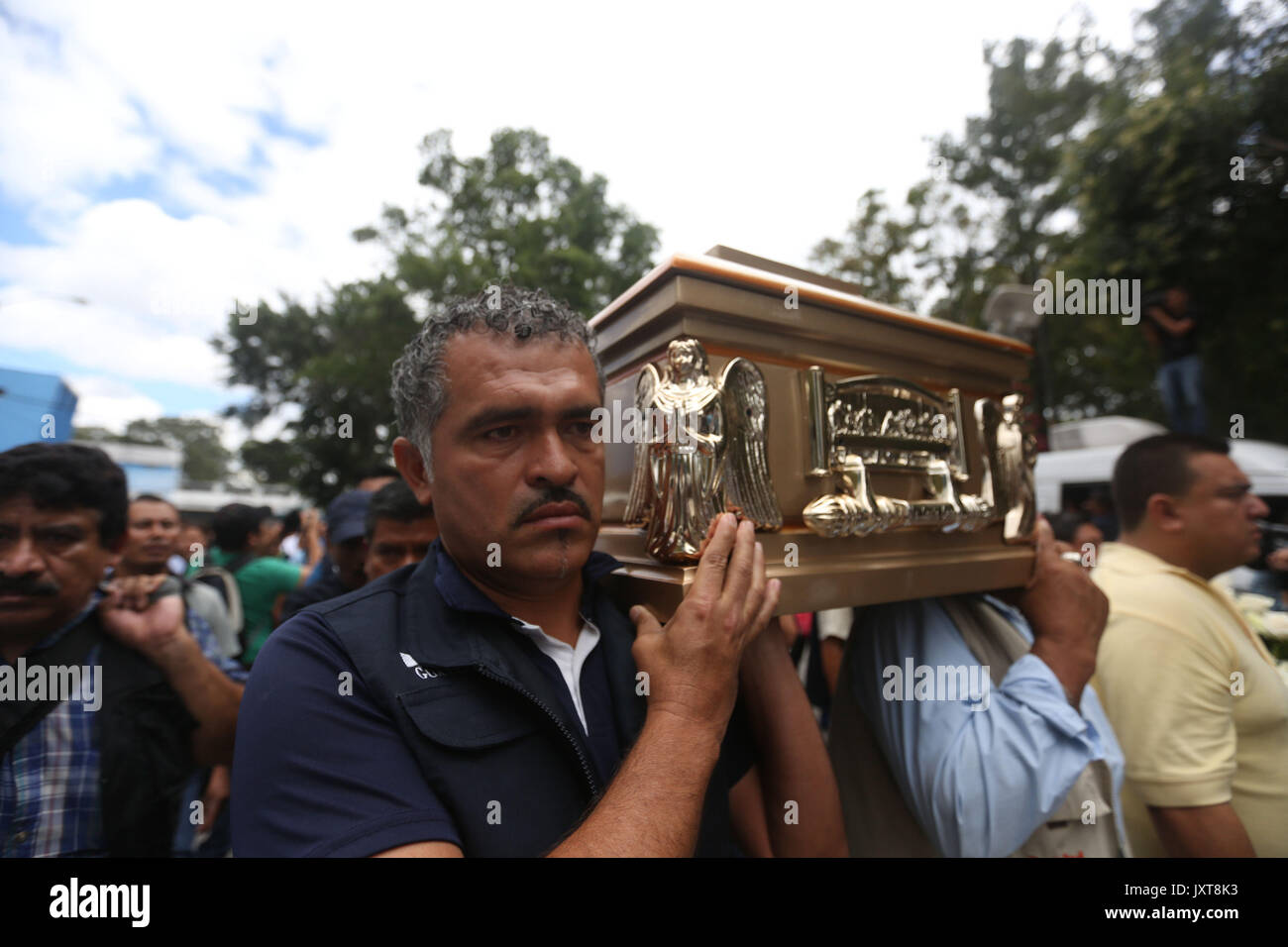 Staff of the Roosevelt Hospital attend the funeral of their colleague Margarito Sucuc in Guatemala City, Guatemala, 17 August 2017. The hospital bid its last farewell to one of its employees who died yesteday along six other people during a shooting perpetrated by a group of gangsters in order to release a member of their group. EFE/Esteban Biba - Stock Image