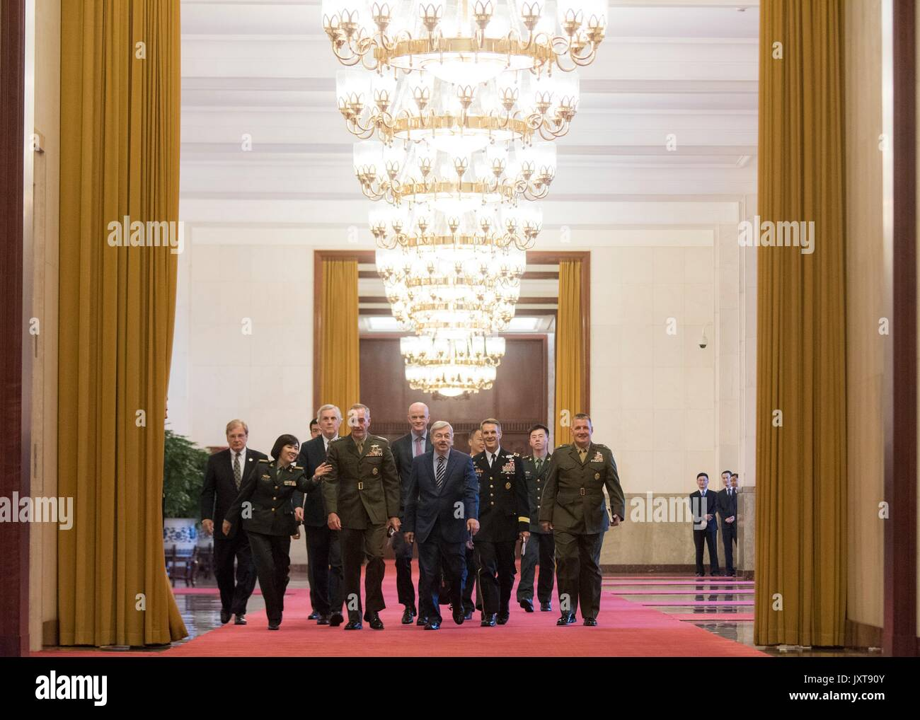 Beijing, China. 17th Aug, 2017. U.S. Chairman of the Joint Chiefs Gen. Joseph Dunford, left, walks with his delegation to meet with Chinese President Xi Jinping at the Great Hall of the People August 17, 2017 in Beijing, China. Dunford is in China to discuss defusing the situation in North Korea. Credit: Planetpix/Alamy Live News - Stock Image