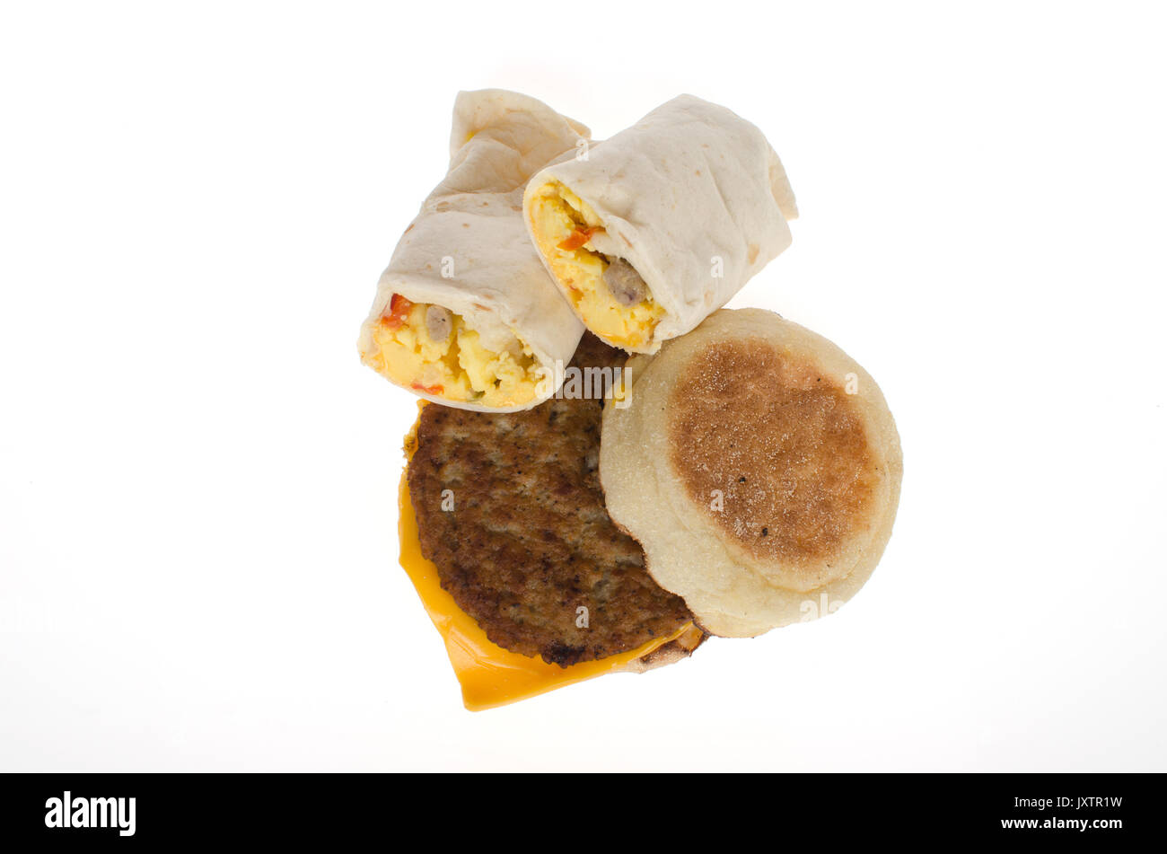McdDonald's sausage burrito and sausage cheese mcmuffin breakfast sandwiches with no wrappers on white background, cut-out. USA - Stock Image