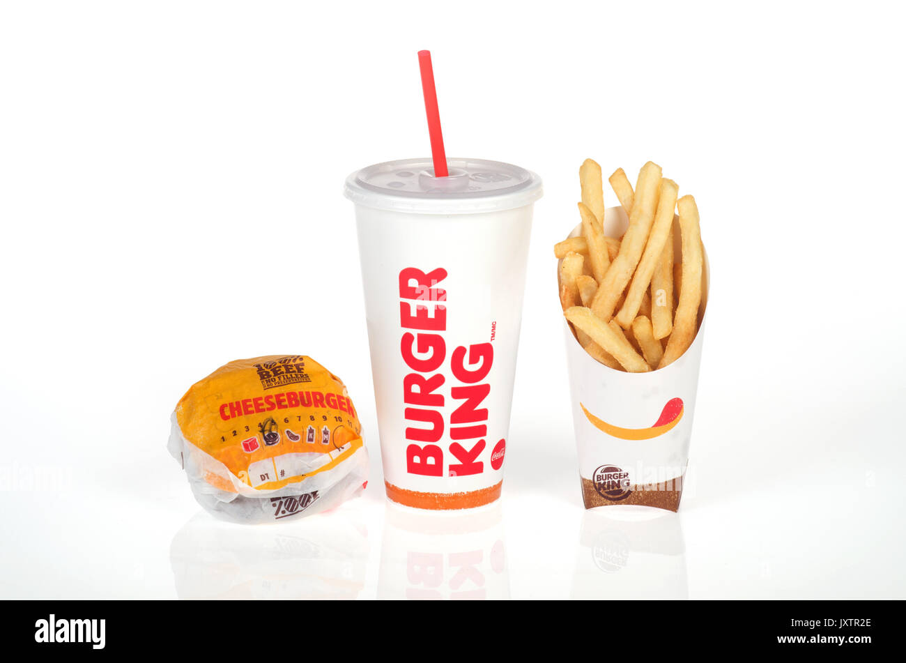 Burger King Meal of double cheeseburger in wrapper with a large fries and drink  with straw on white background, isolated. USA - Stock Image