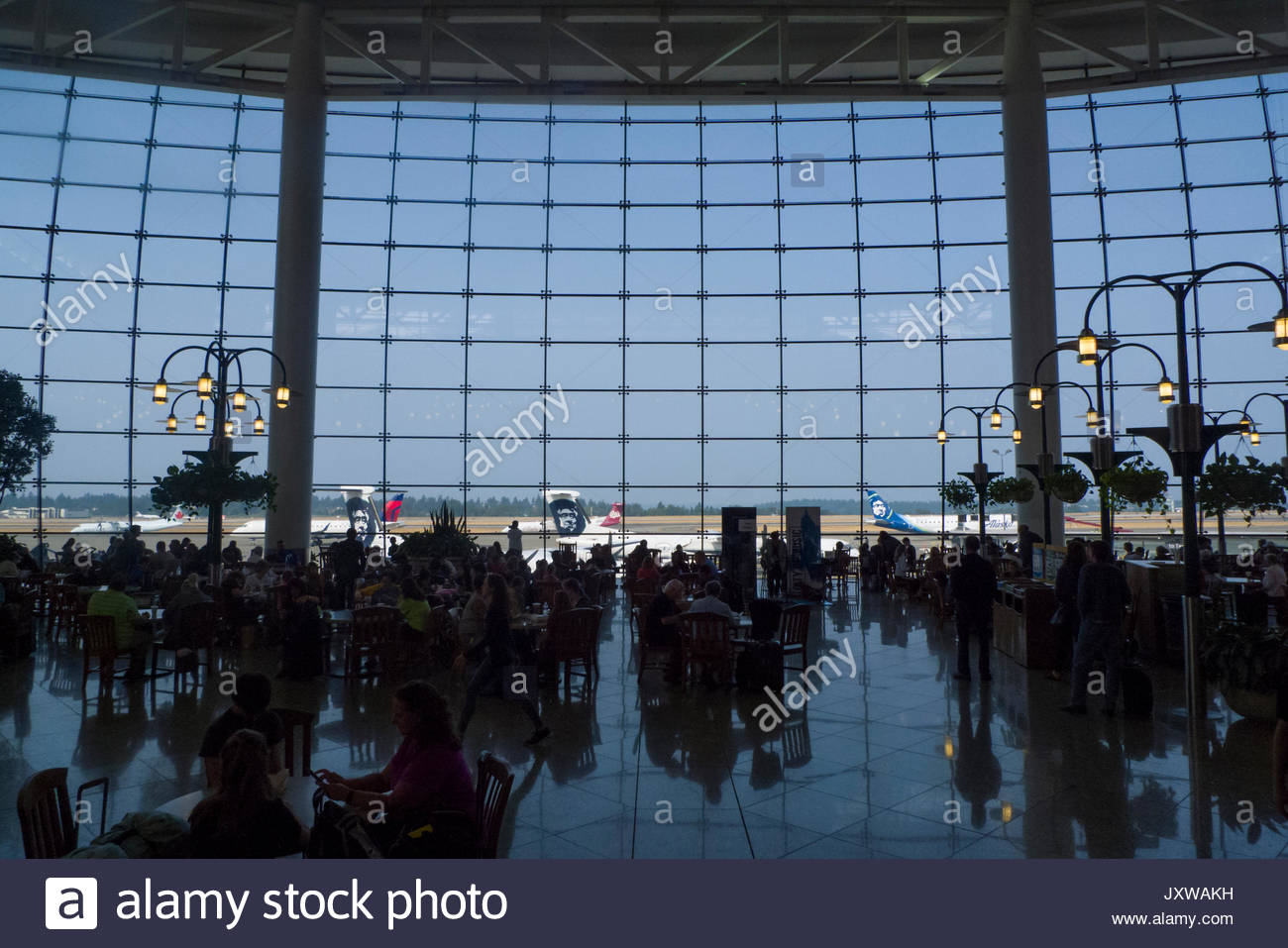 60-foot tall floor to ceiling west-facing structural glass curtain wall in the Central Terminal at SeaTac International Stock Photo