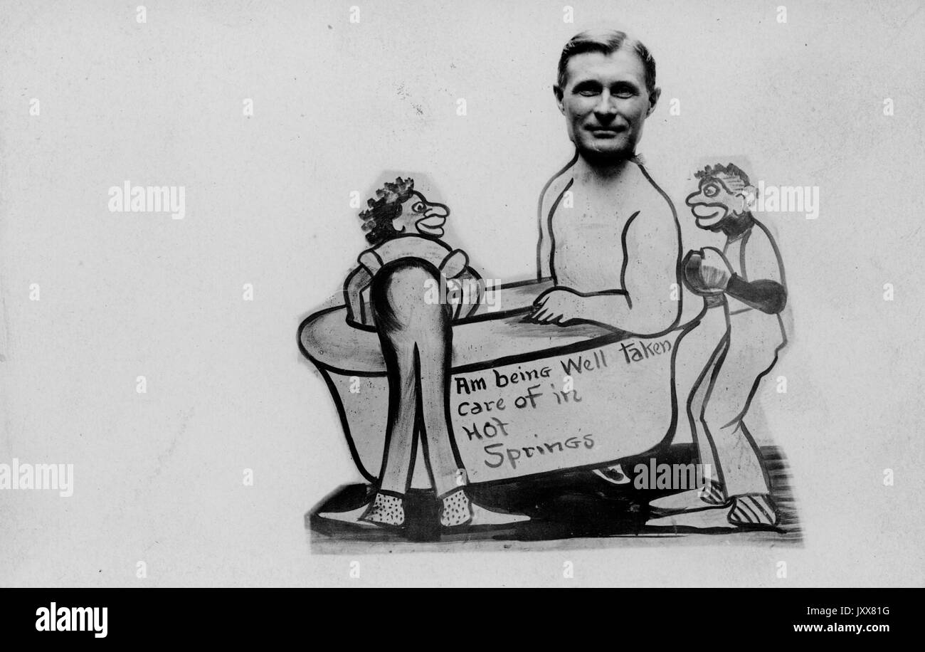 Two racially prejudiced caricatures of African American men tend to a Caucasian man in a bathtub that reads 'Am being Well taken care of in Hot Springs', 1915. - Stock Image