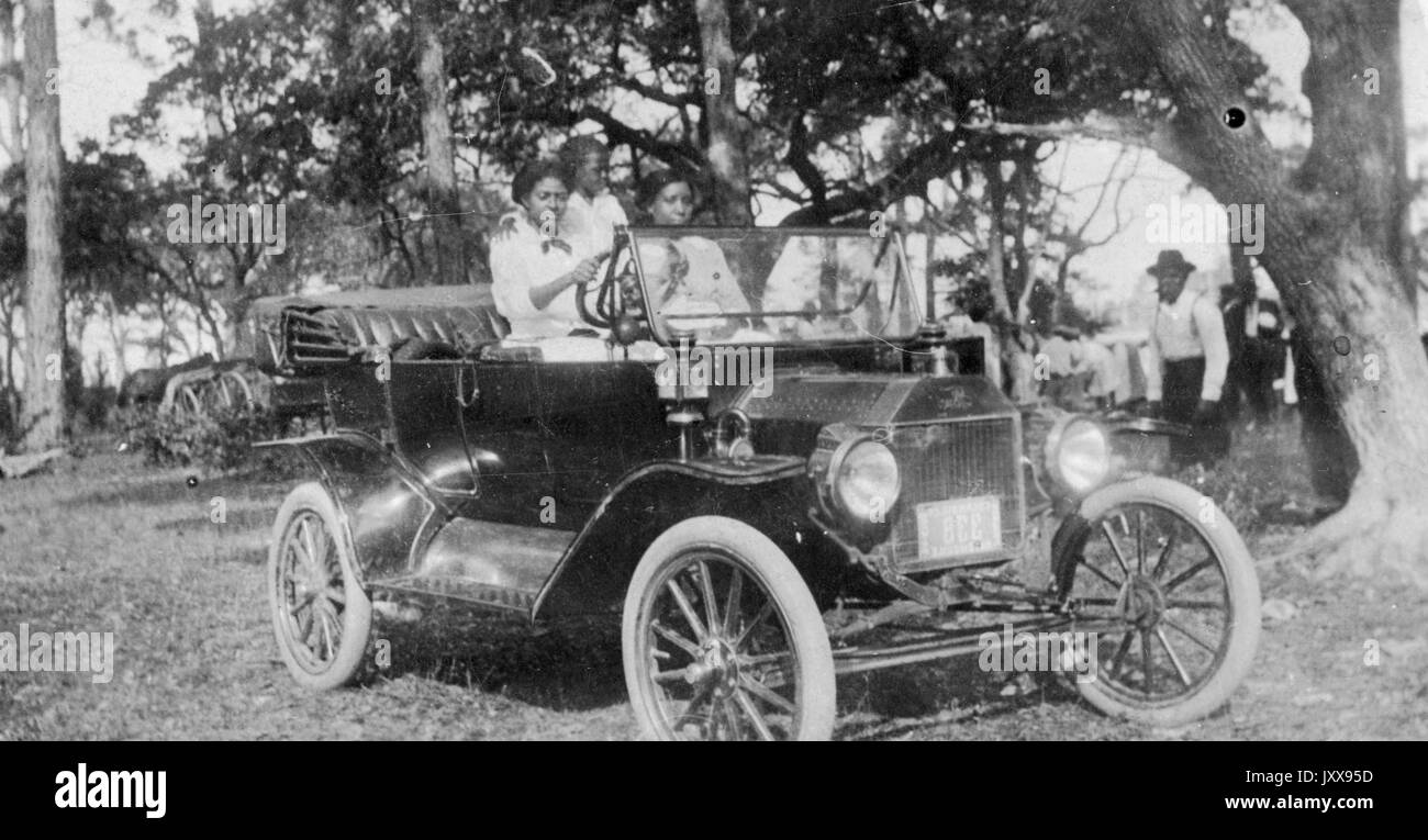 Full Length Portrait Of Three African American Girls Driving A Car