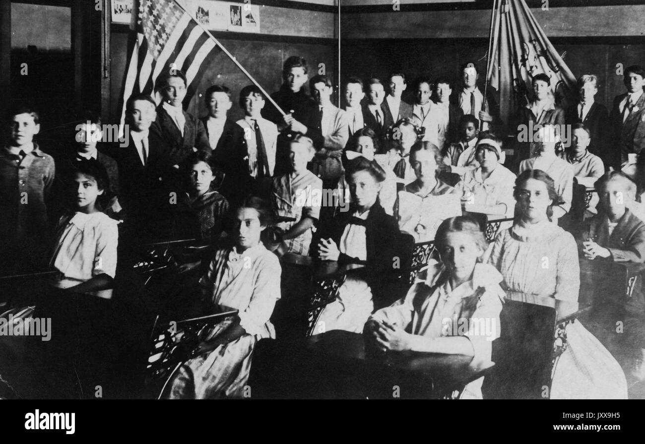 4b90a564f5d Landscape full length shot of Caucasian students indoors seated at desks