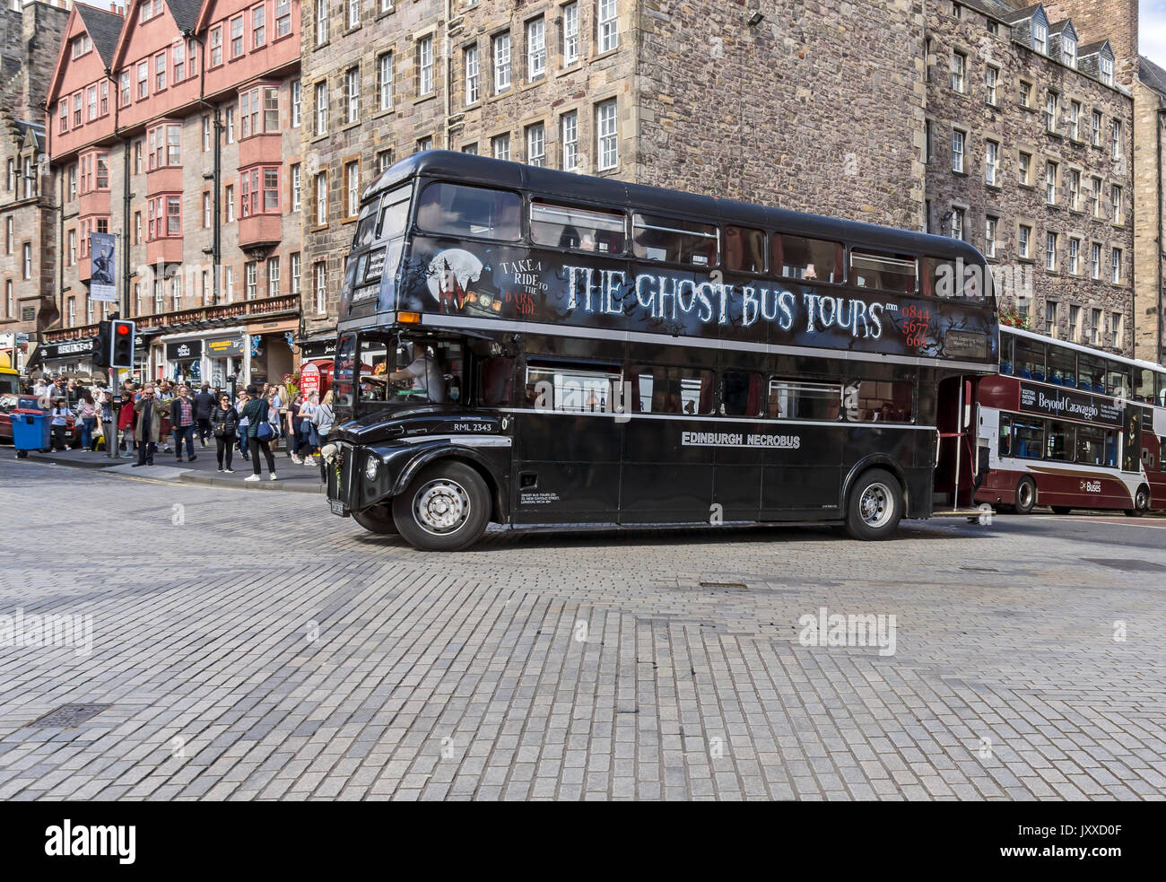 The Ghost Bus Tours bus is turning into Lawnmarket from Bank Street during Edinburgh Festival Fringe 2017 Edinburgh Scotland UK - Stock Image