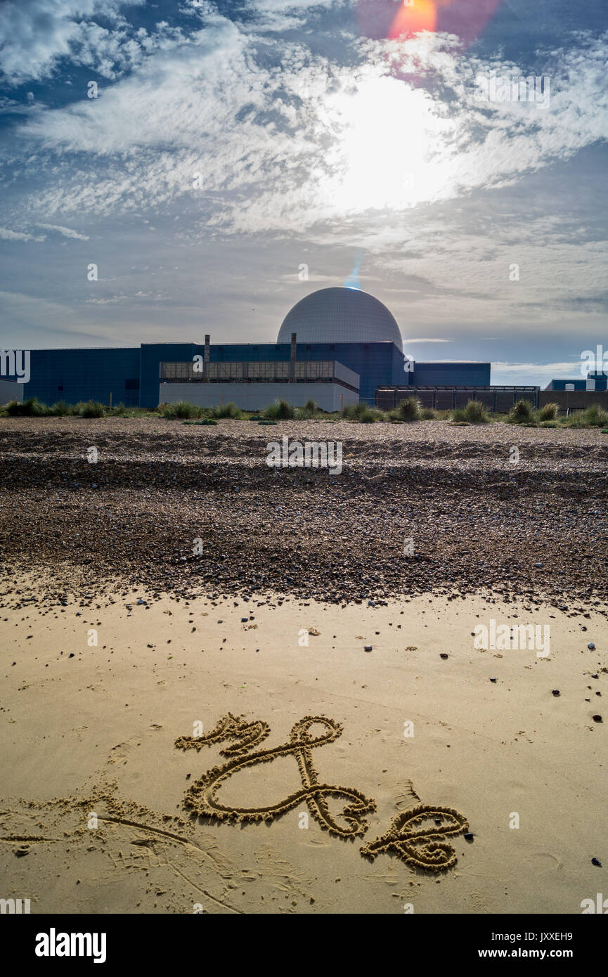 Writing in the sand in front of the dome of Sizewell B PWR nuclear reactor, Sizewell Beach, Suffolk, England - Stock Image