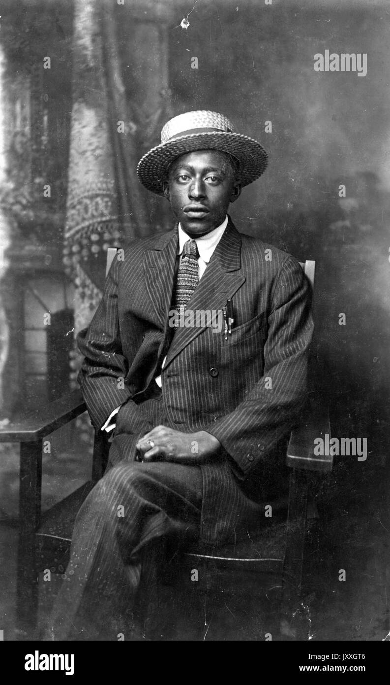 Full length sitting portrait of mature African American man 7f5b437e369e