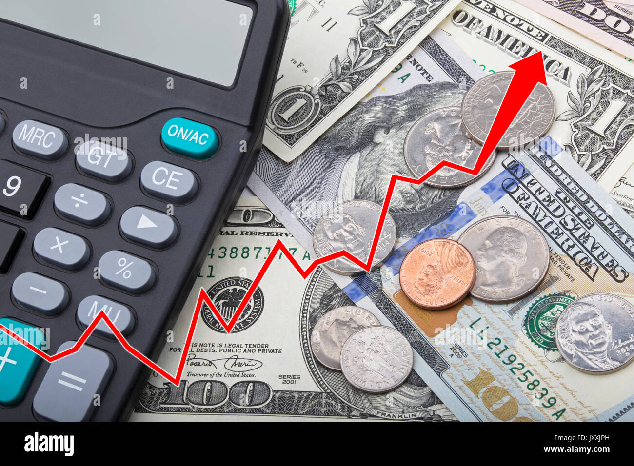 Graph showing economy strengthening of United States bank notes and coins with a calculator - Stock Image