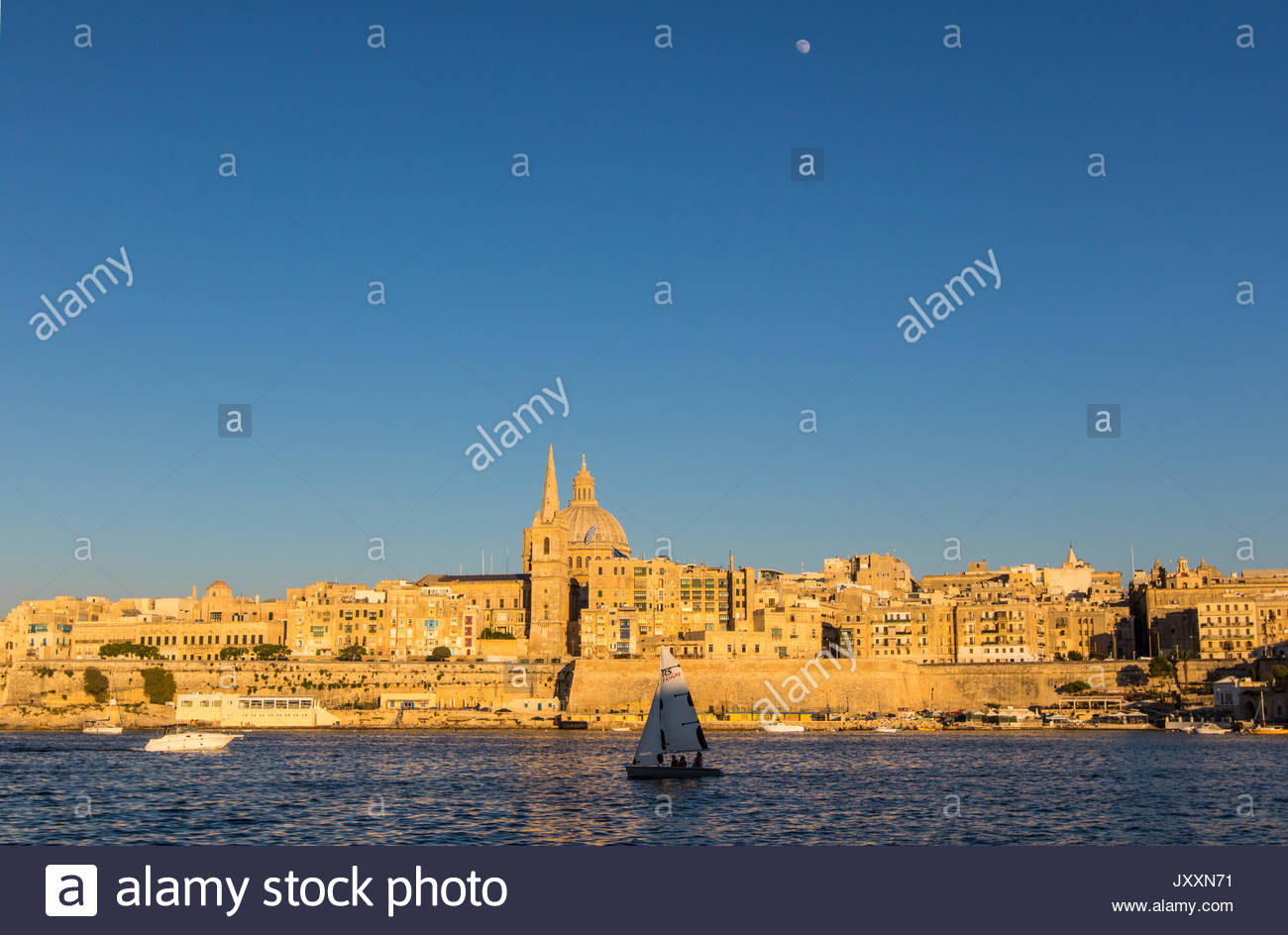 looking from manoel island over marsamxett harbour to valletta with the st. paul's pro-cathedral and basilica of Stock Photo