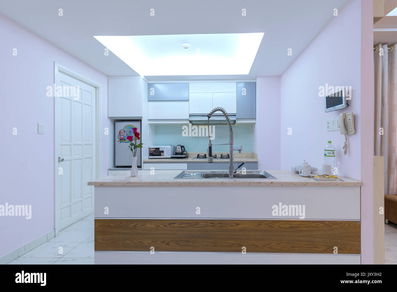 Ho Chi Minh City, Vietnam - May 5th, 2017: Modern dining room, kitchen in luxury apartments with airy, clean amenities, luxurious interior is dream of - Stock Image