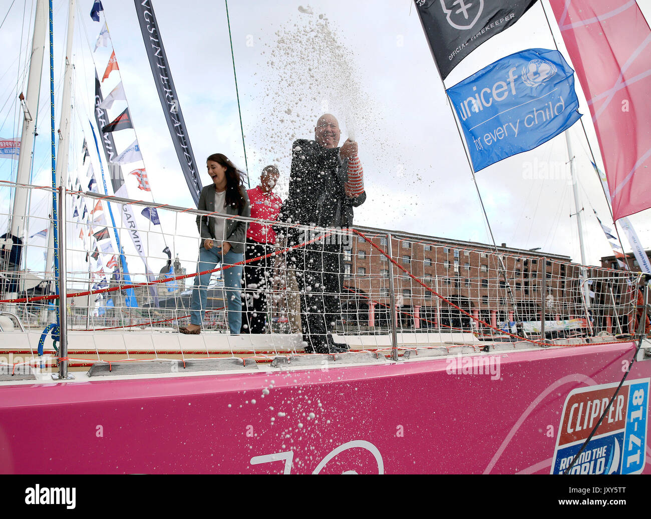 Lord Mayor of Liverpool Joe Anderson sprays champagne during the naming ceremony of Liverpool 2018 at Albert Docks, Liverpool ahead of this Sunday's start of the Clipper Round the World yacht race. - Stock Image