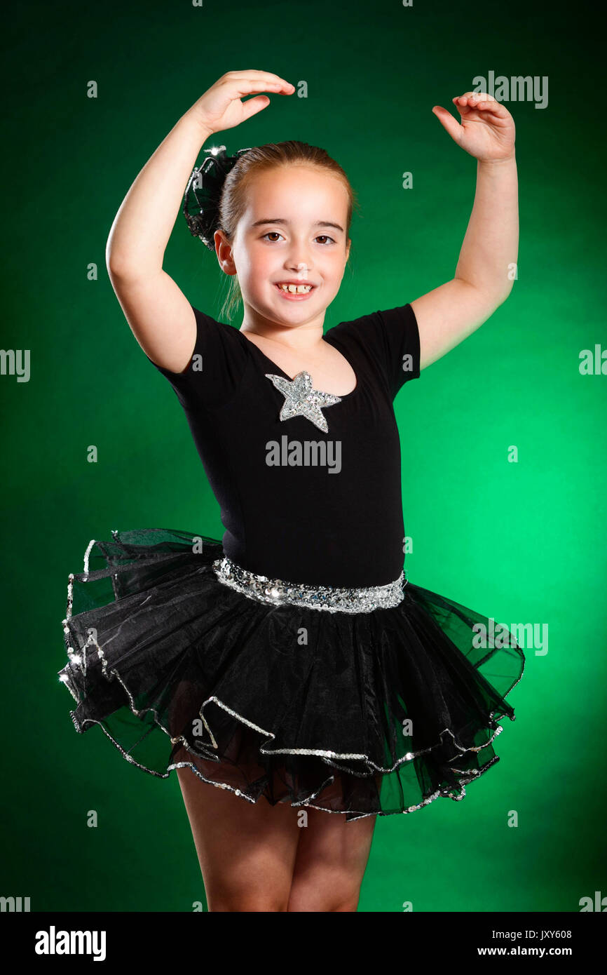 f1a13e0f654e44 Studio portrait photograph of a 7 year old young white female dancer  wearing dance clothes -