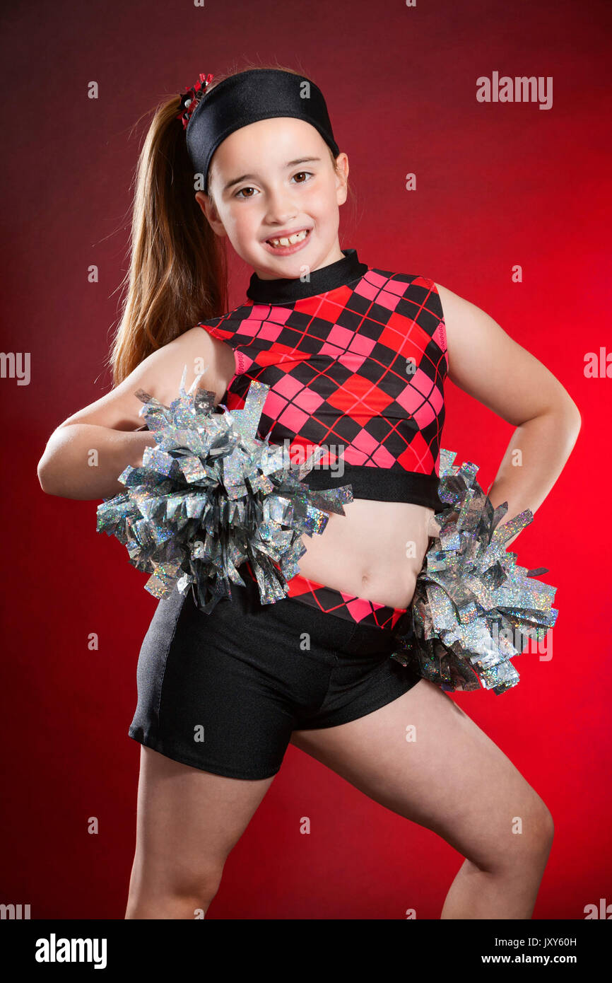 c49937499fd120 Studio portrait photograph of a 7 year old young white female dancer  wearing dance clothes