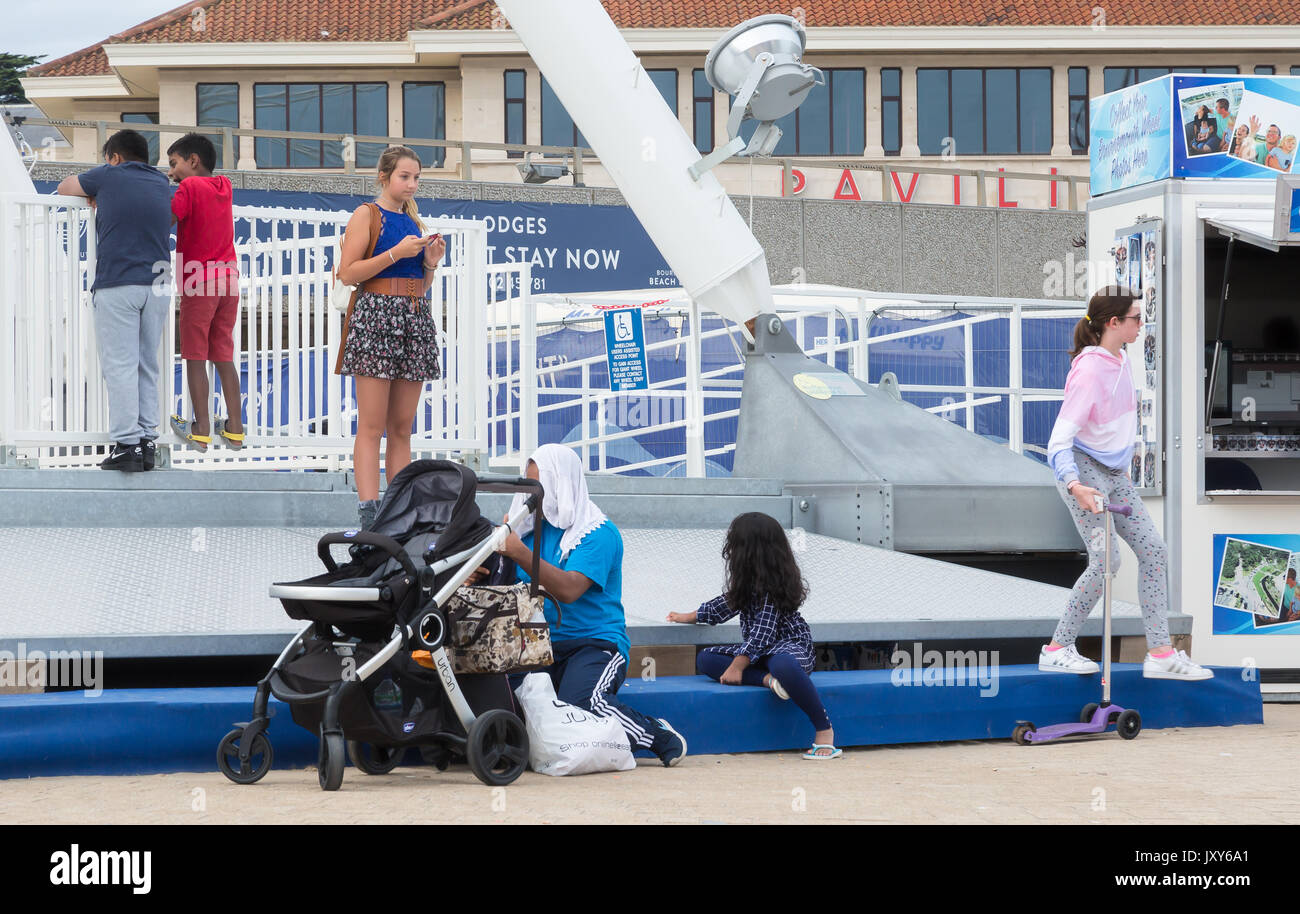 Bournemouth SeaFront and Pier on a beautiful evening. 16th August 2017, people walking around and generally having Stock Photo