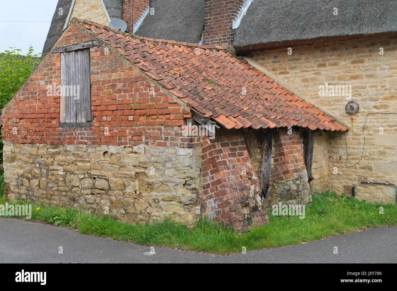 The Old Bakehouse in the village of Geddington, Northamptonshire, UK - Stock Image