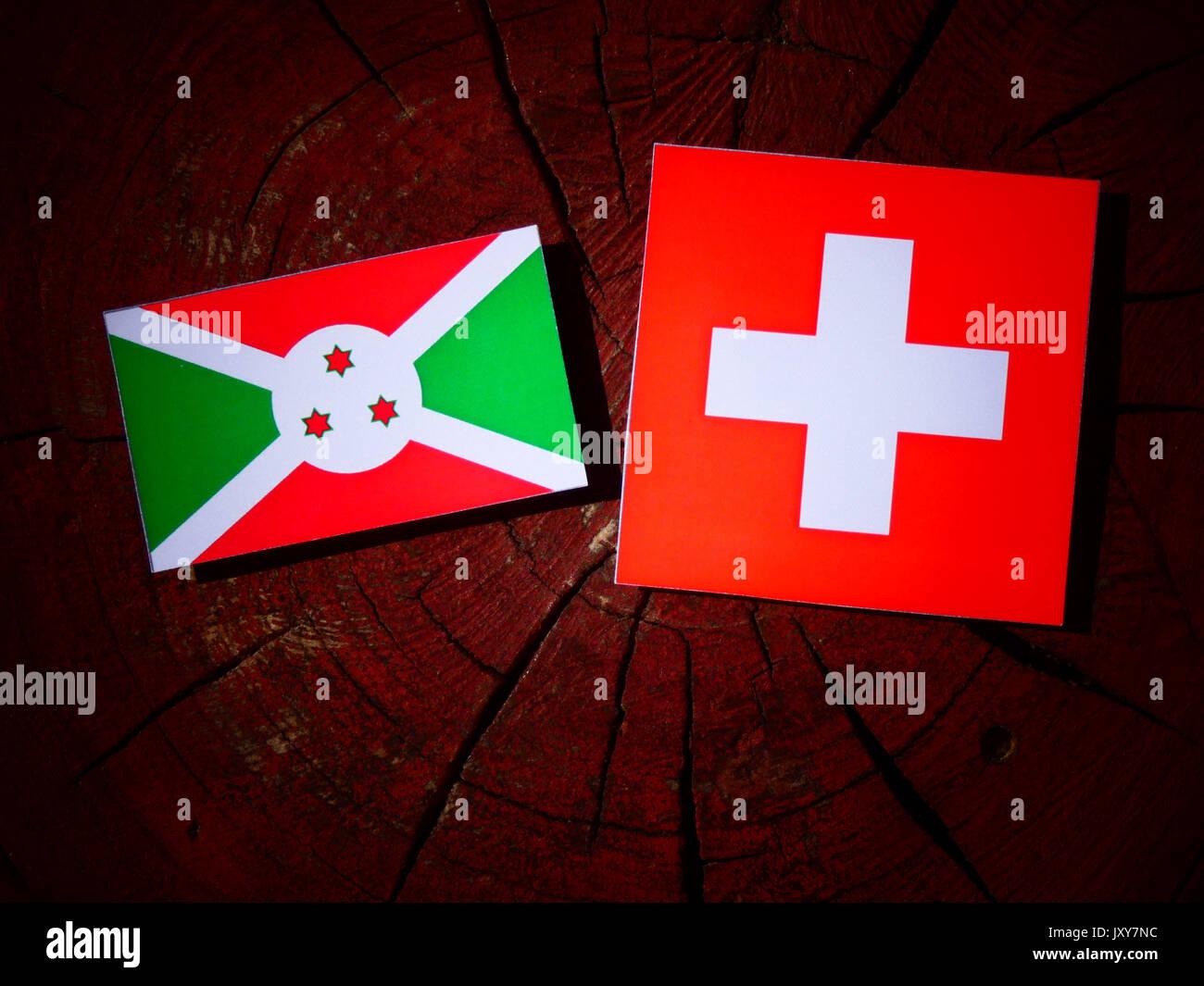 Burundi flag with Swiss flag on a tree stump isolated Stock Photo