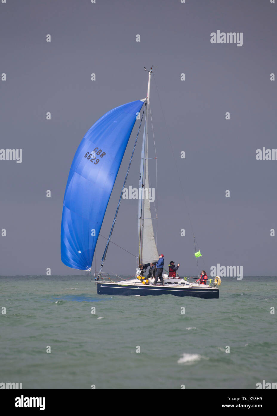 Swan 38 GBR2048R Acco under spinnaker in stormy skies during the 2017 Round the Island Race - Stock Image