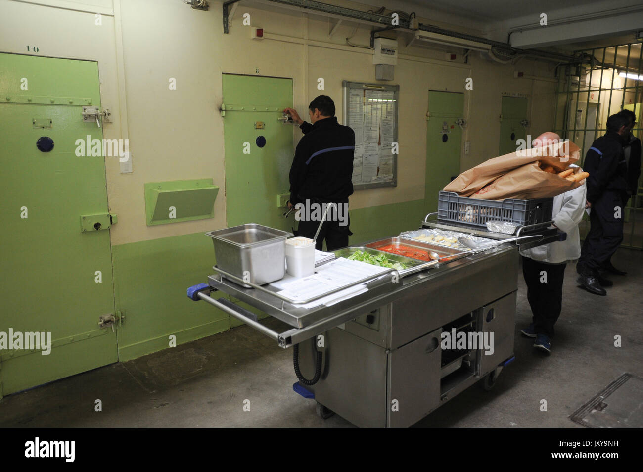 Saint-Martin-de-Re on 2015/10/02: distribution of meal in the prison of Saint-Martin-de-Re. Prisoner beside a prison warden in front of a cell - Stock Image