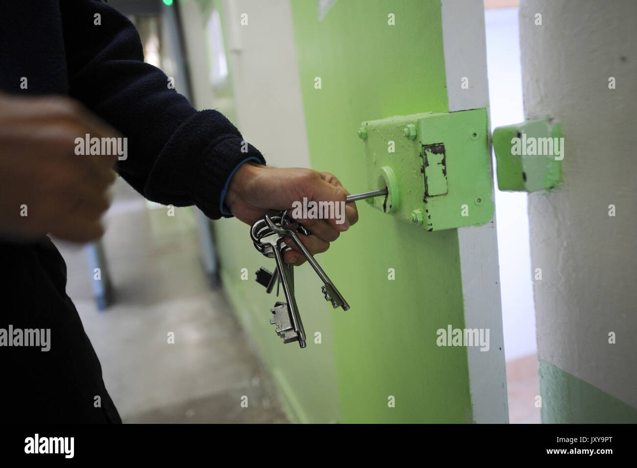 Saint-Martin-de-Re on 2015/10/02: prison warden opening a cell with his bundle of keys - Stock Image