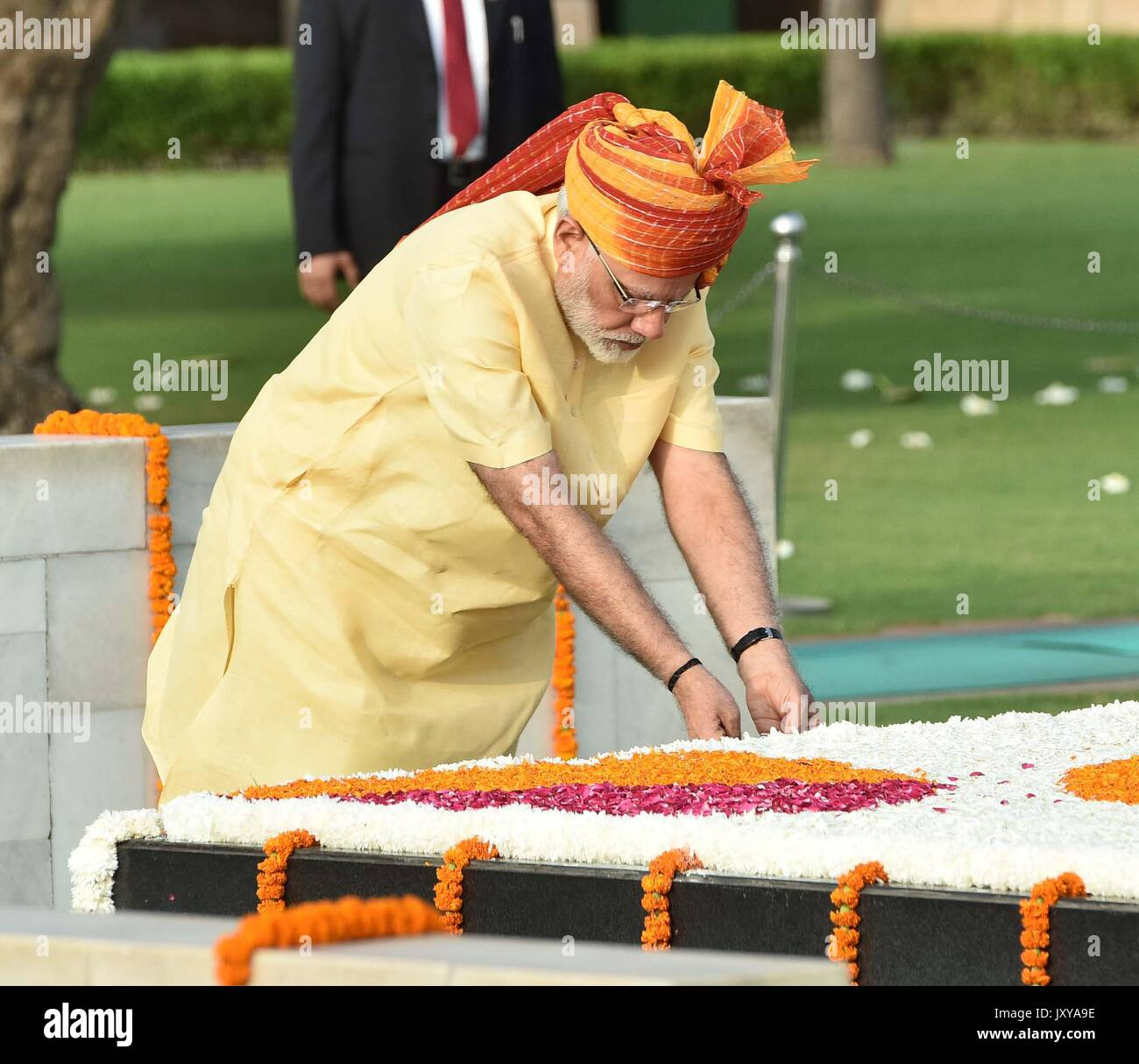 Indian Prime Minister Narendra Modi places flower petals on the Samadhi of Mahatma Gandhi, at Raj ghat marking the 70th anniversary of Independence from British colonial rule August 15, 2017 in Delhi, India. - Stock Image