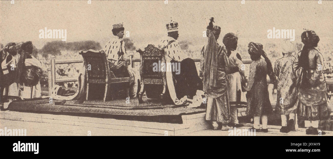 1911 - The British King George V and Queen Mary as Emperor and Empress are presented to the people at the Delhi Durbar assembly  at the Shaj (Sha) Jehan Palace, Delhi, India. - Stock Image