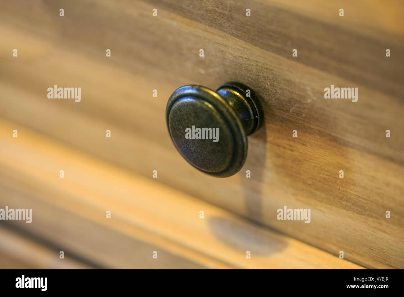 Steel drawer handle in a vintage furniture - Stock Image
