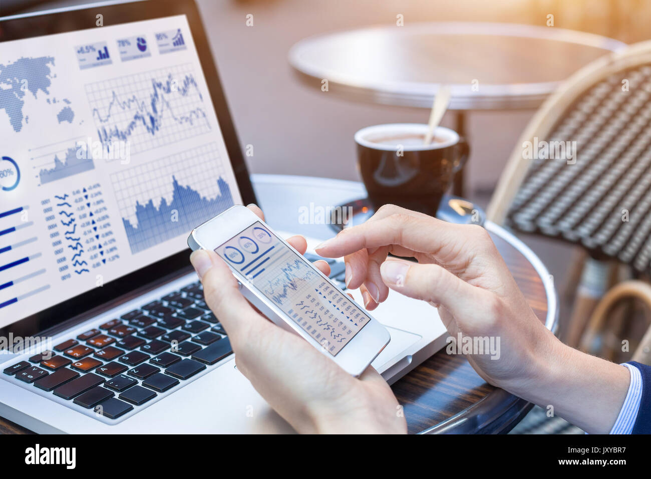 Close-up of hands of businesswoman analyzing stock market charts and key performance indicators (KPI) with business intelligence (BI) on notebook comp - Stock Image
