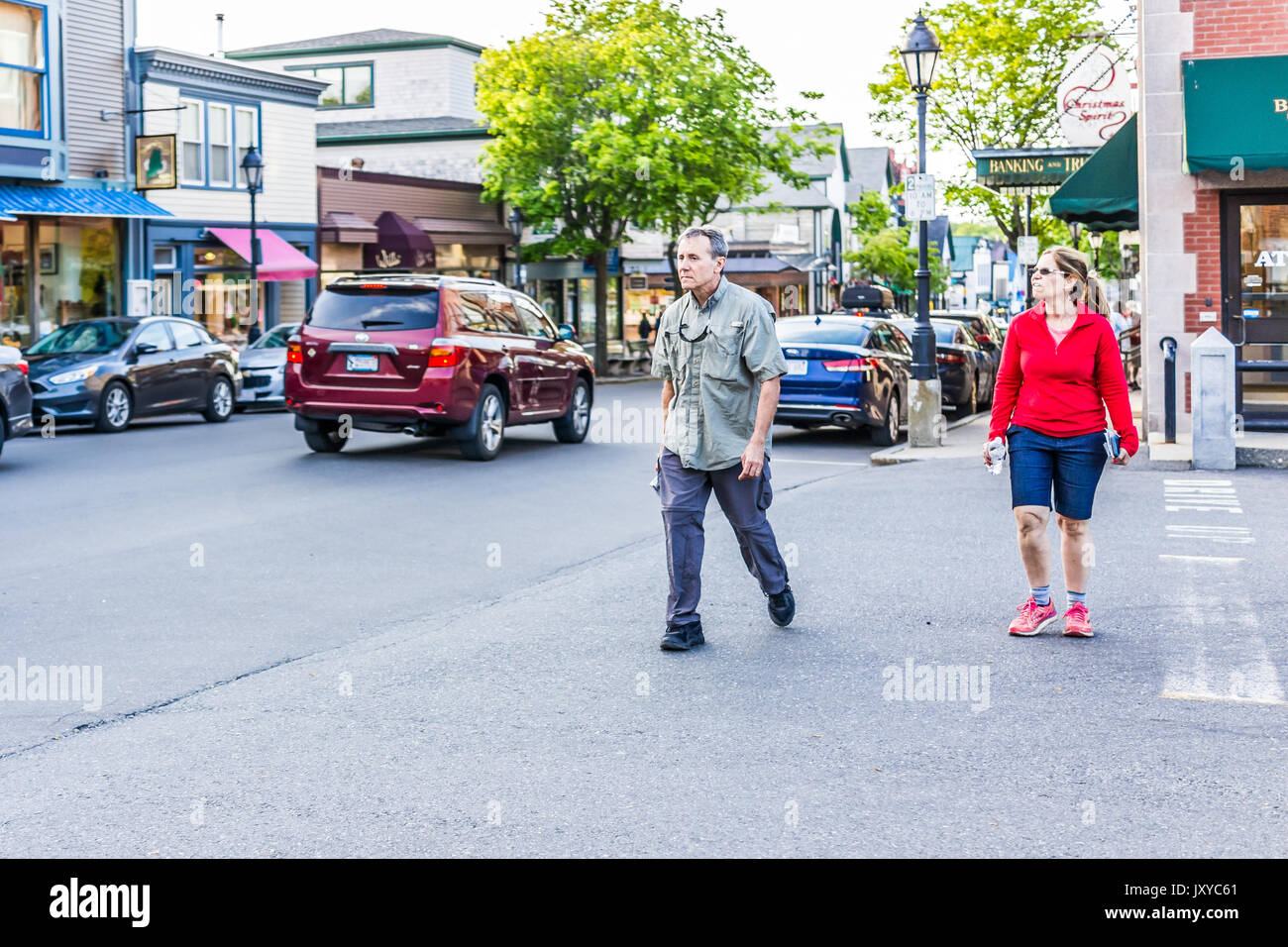 Bar Harbor, USA - June 8, 2017: People crossing sidewalk street in downtown village in summer on main road - Stock Image