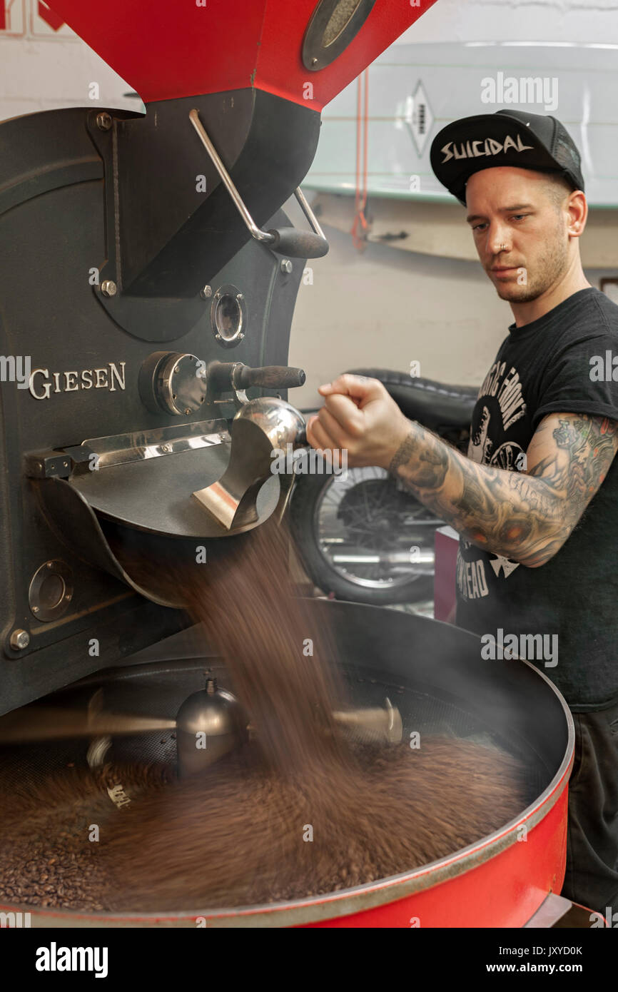 Roasting coffee beans in Deluxe Coffeeworks in Cape Town, South Africa. - Stock Image